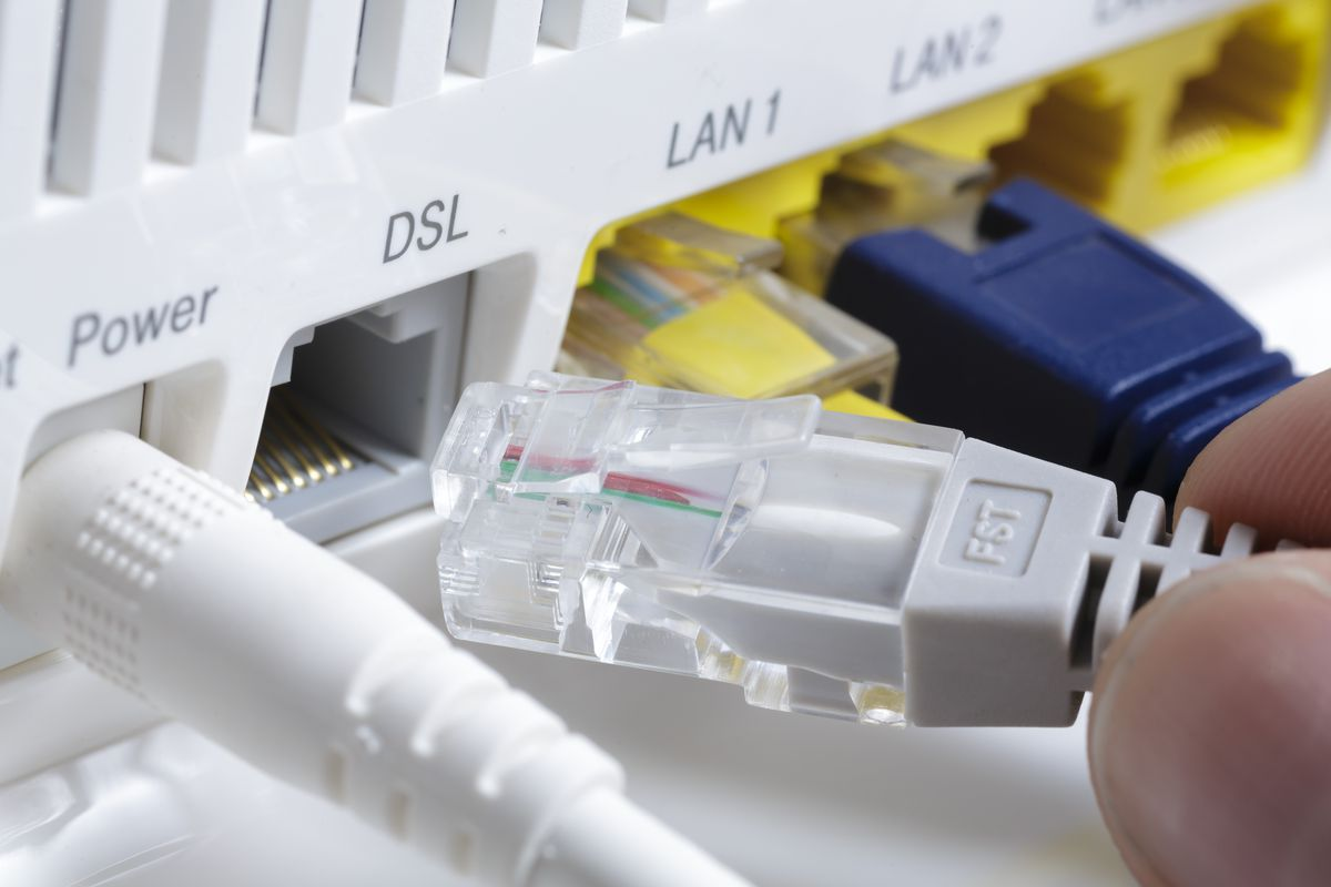 plugging a network cable into a DSL port on a router