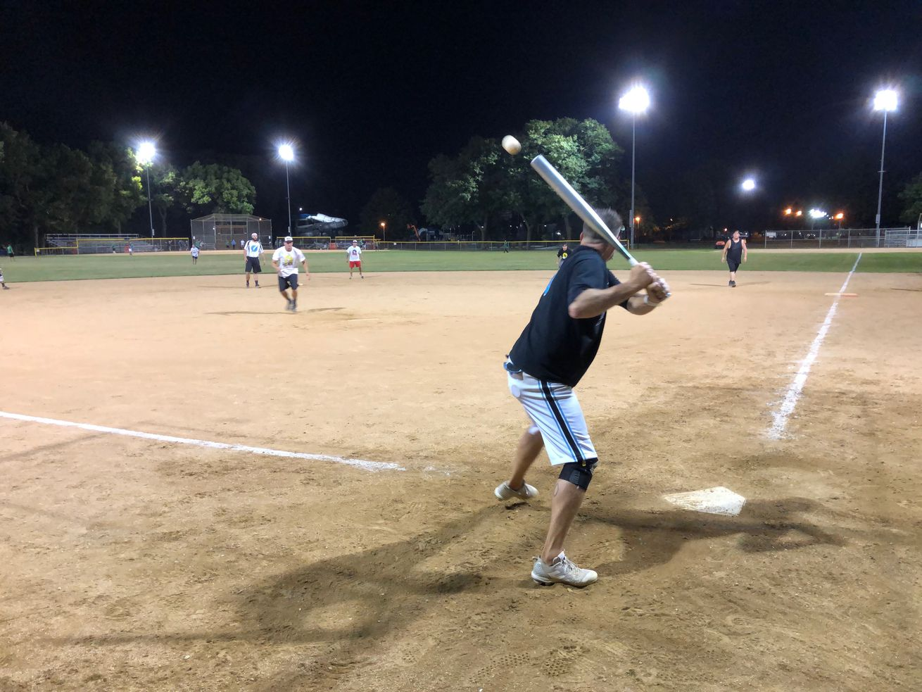 Ralph Lawrence of the Flashback team prepares to swing at a pitch from opposing Hexx at an Aug. 12, 2020, game in Forest Park.