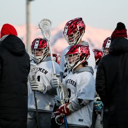 American Fork players huddle in a timeout in a boys lacrosse game against Lone Peak in American Fork on Tuesday, March 30, 2021.