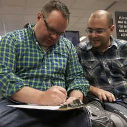 Jason McDermaid, left, fills out a marriage certificate with Zachary Smallwood at the Salt Lake County Clerk's Office in Salt Lake City, Monday, Oct. 6, 2014.