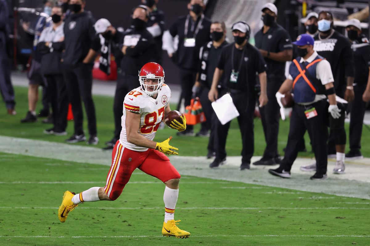 Tight end Travis Kelce #87 of the Kansas City Chiefs runs with the football after a reception against the Las Vegas Raiders during the NFL game at Allegiant Stadium on November 22, 2020 in Las Vegas, Nevada. The Chiefs defeated the Raiders 35-31.