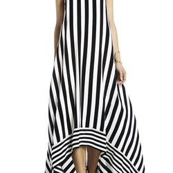 """Add a leather jacket and moto boots for cooler days, pair with a nude wedge for warm weather. Either way you'll be perfectly on-trend in black and white. $548 at <a href=""""http://www.bcbg.com/Gia-Silk-High-Low-Striped-Dress/DQH6M937-003,default,pd.html?dwv"""
