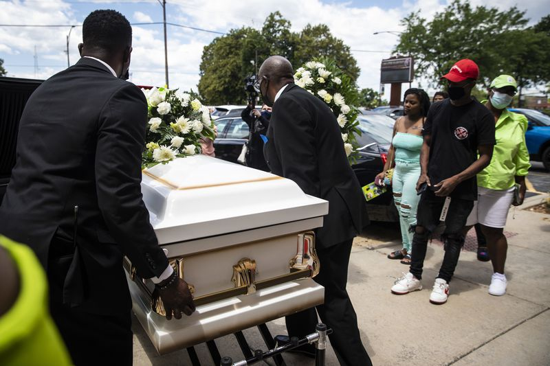 Pallbearers carry the casket to the hearse for 13-year-old Jamari Dent after his funeral at Greater Harvest Baptist Church at 5141 S. State St. in Washington Park on the South Side, Tuesday, June 22, 2021.