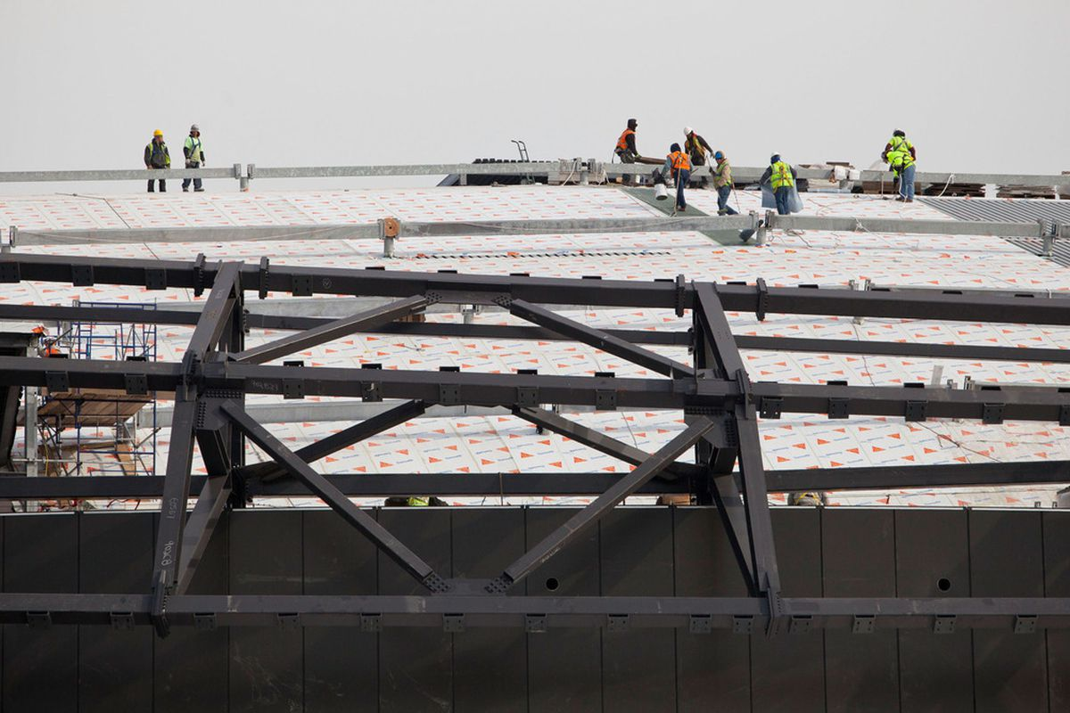 Construction workers create the roof hatch in Brooklyn where Jean-Claude Van Damme will enter.