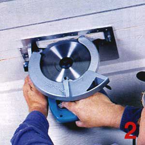 Person cutting a soffit vent with a circular saw.