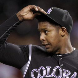 Colorado Rockies starting pitcher Juan Nicasio reacts after a meeting at the mound during the third inning of a baseball game against the Arizona Diamondbacks, Friday, April 13, 2012, in Denver. Nicasio was pulled after the next batter.