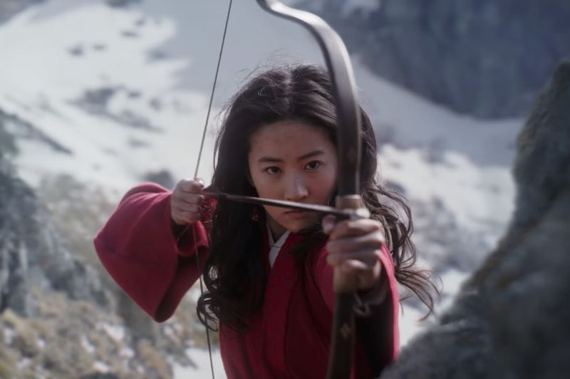 Liu Yifei shoots an arrow from a bow in Mulan.