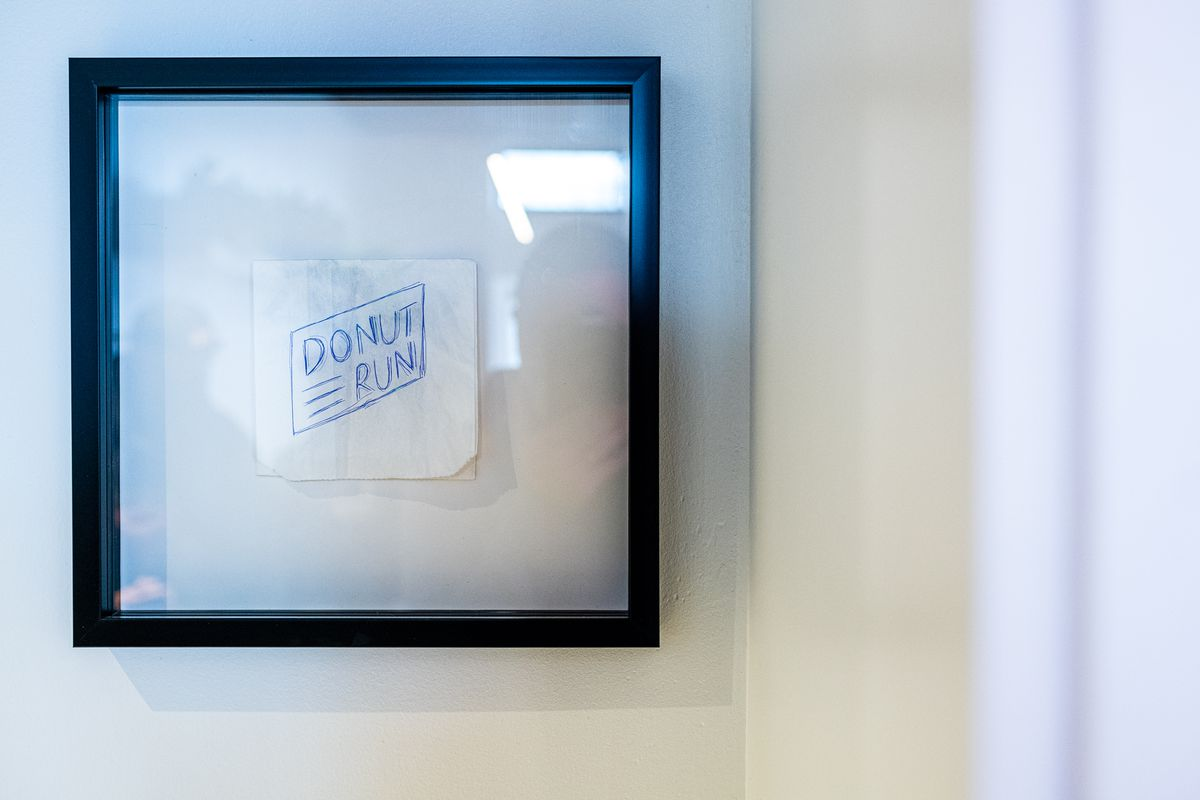 The original sketch of the Donut Run name was scribbled on a doughnut bag that's framed in the shop