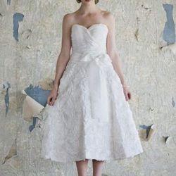 "<a href=""http://shopruche.com/charlotte.html""> Charlotte wedding gown</a>, $499.99 at ruche.com."