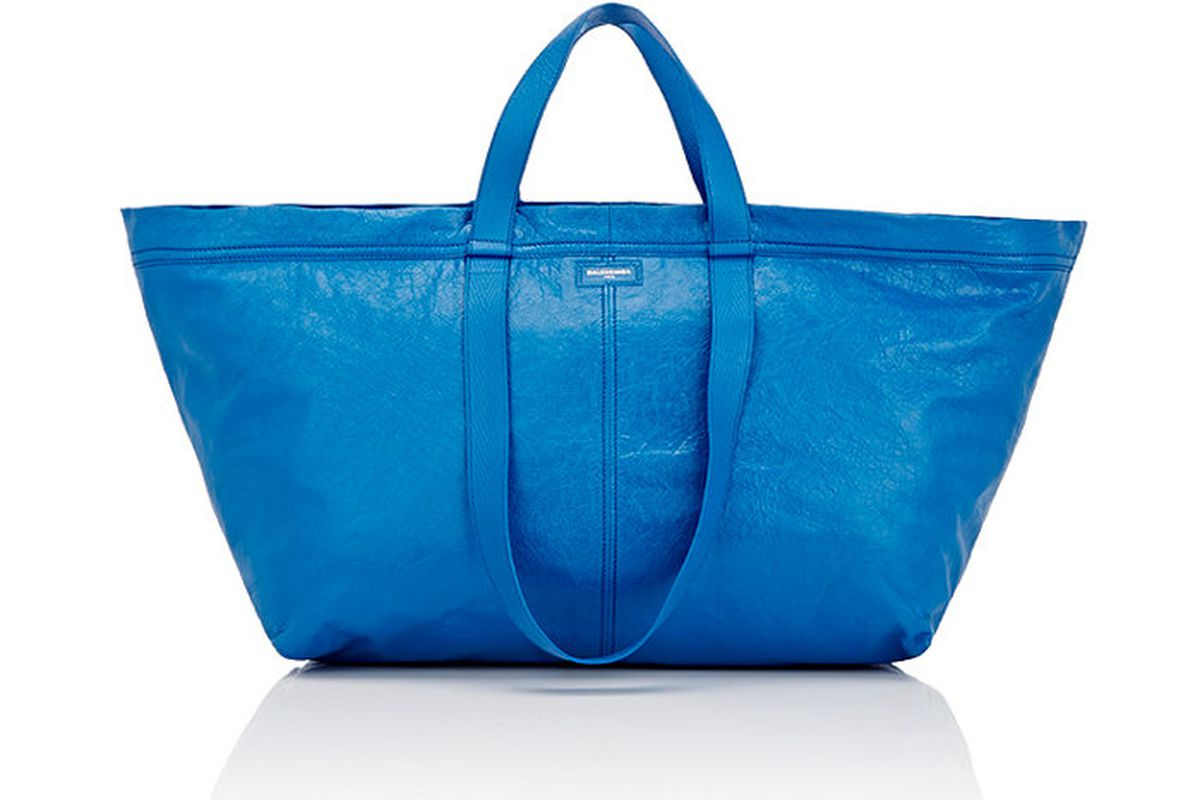 Large leather tote in bright blue with double straps.