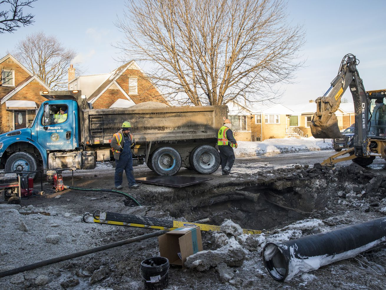 Chicago Department of Water Management employees at a water main break in January 2019.