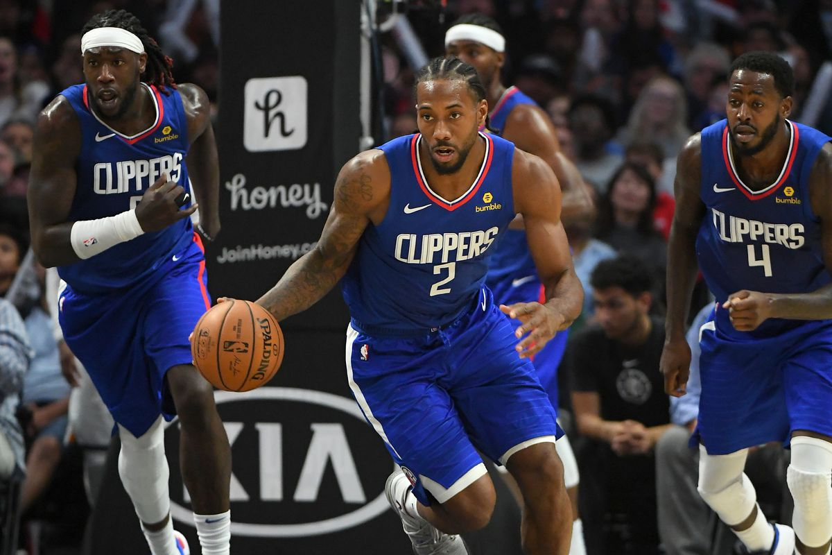 Los Angeles Clippers forward Kawhi Leonard dribble up court as forward Montrezl Harrell and forward JaMychal Green react in the second half of the game against the Utah Jazz at Staples Center.