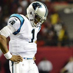 Carolina Panthers quarterback Cam Newton (1) reacts after losing a fumble during the second half of an NFL football game against the Atlanta Falcons, Sunday, Sept. 30, 2012, in Atlanta. The Falcons won 30-28.