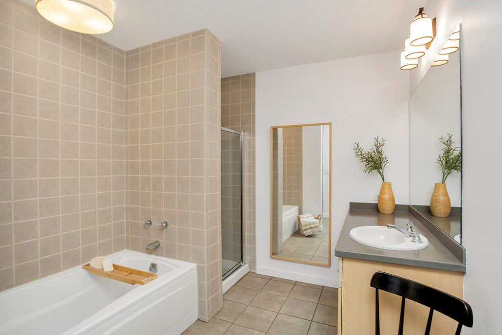 A master bathroom with beige tile on the walls.