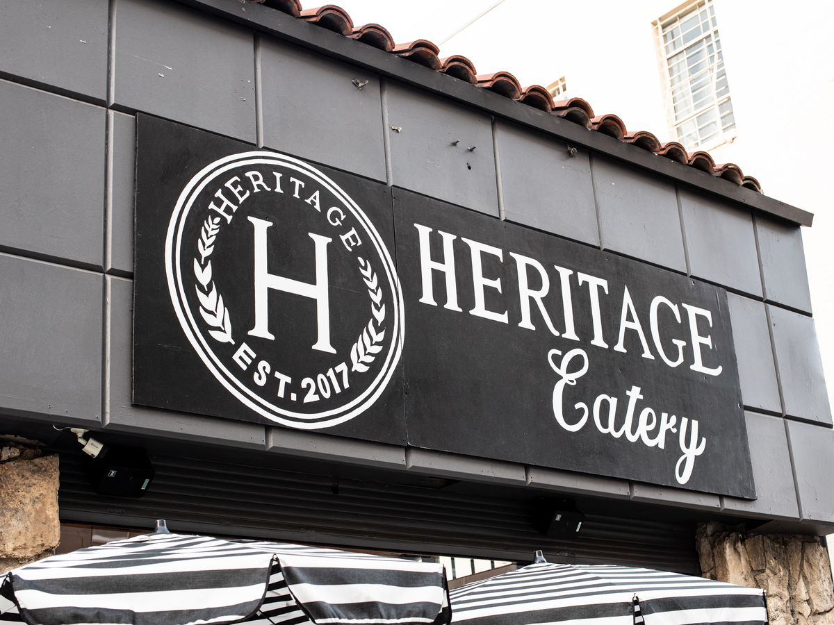 The black and white sign outside Heritage Eatery
