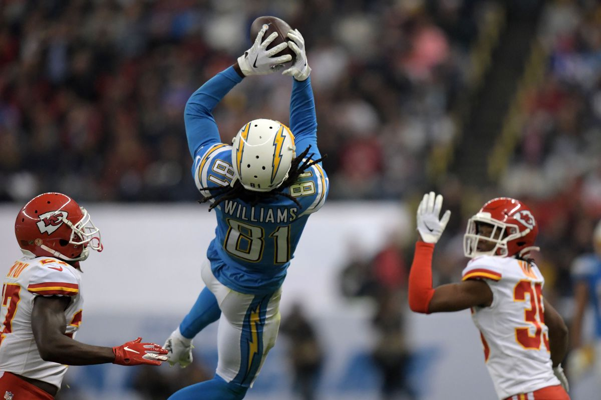 Los Angeles Chargers wide receiver Mike Williams makes a 50-yard reception in the fourth quarter as Kansas City Chiefs defensive back Rashad Fenton and cornerback Charvarius Ward defend during an NFL International Series game at Estadio Azteca.