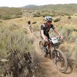 Alta High junior Madeleine Hales competes for her school bike racing team during a race at Soldier Hollow Saturday, Aug. 29, 2015.