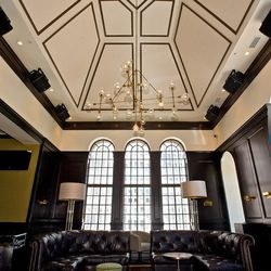 The great room features 25-foot-tall vaulted ceilings
