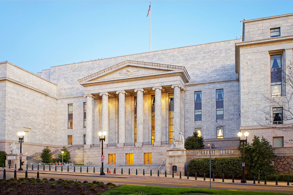 A federal government building with classical columns and a small plaza.