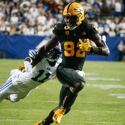 Arizona State wide receiver Andre Johnson (82) runs toward a touchdown as Brigham Young defensive back Isaiah Herron (11) tries to defend during an NCAA college football game at LaVell Edwards Stadium in Provo on Saturday, Sept. 18, 2021.