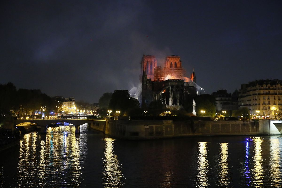 Notre Dame cathedral is seen burning in Paris, Monday, April 15, 2019. A catastrophic fire engulfed the upper reaches of Paris' soaring Notre Dame Cathedral as it was undergoing renovations Monday, threatening one of the greatest architectural treasures o