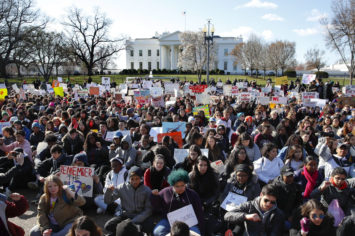 Students rally in front of the White House in Washington, Wednesday, March 14, 2018. Students walked out of school to protest gun violence in the biggest demonstration yet of the student activism that has emerged in response to last month's massacre of 17