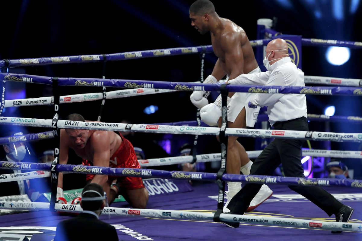 The referee stops the fight as Anthony Joshua knocks down Kubrat Pulev during the IBF, WBA, WBO and IBO World Heayweight Title fight between Anthony Joshua and Kubrat Pulev at The SSE Arena, Wembley on December 12, 2020 in London, England.