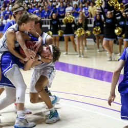Dixie's Andy Rich (0) fights for control of the ball late into the fourth quarter of the 4A boys championship basketball game at the Dee Events Center in Ogden on Saturday, Feb. 29, 2020.