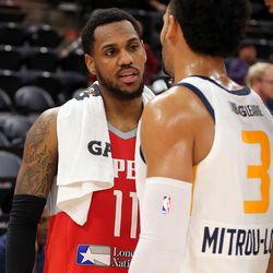 Rio Grande Valley Vipers' Monte Morris (No. 11) and Salt Lake City Stars' Naz Mitrou-Long (No. 3), who were former Iowa State teammates, talk after playing in an NBA G league basketball game at the Vivint Smart Home Arena in Salt Lake City on Monday, Nov. 27, 2017.