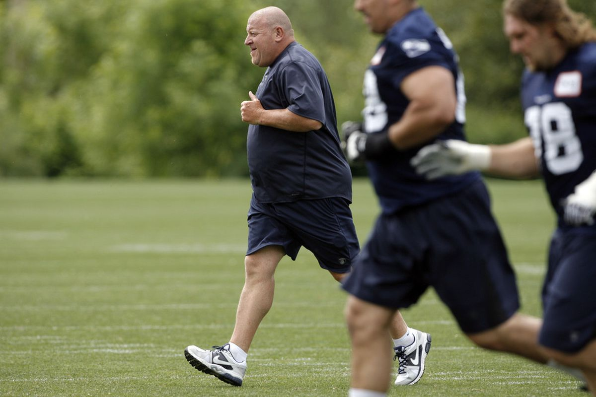 May 30, 2012; Renton, WA, USA; Seattle Seahawks offensive line coach Tom Cable participats in a running drill following an OTA practice at the Virginia Mason Athletic Center. Mandatory Credit: Joe Nicholson-US PRESSWIRE