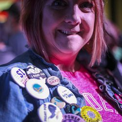 """Genevra Prothero sports buttons on her jean jacket before Vermont Sen. Bernie Sanders and Democratic National Committee Chairman Tom Perez speak during the """"Come Together and Fight Back"""" tour at the Rail Event Center in Salt Lake City on Friday, April 21, 2017.  About 3,000 people attended the event."""