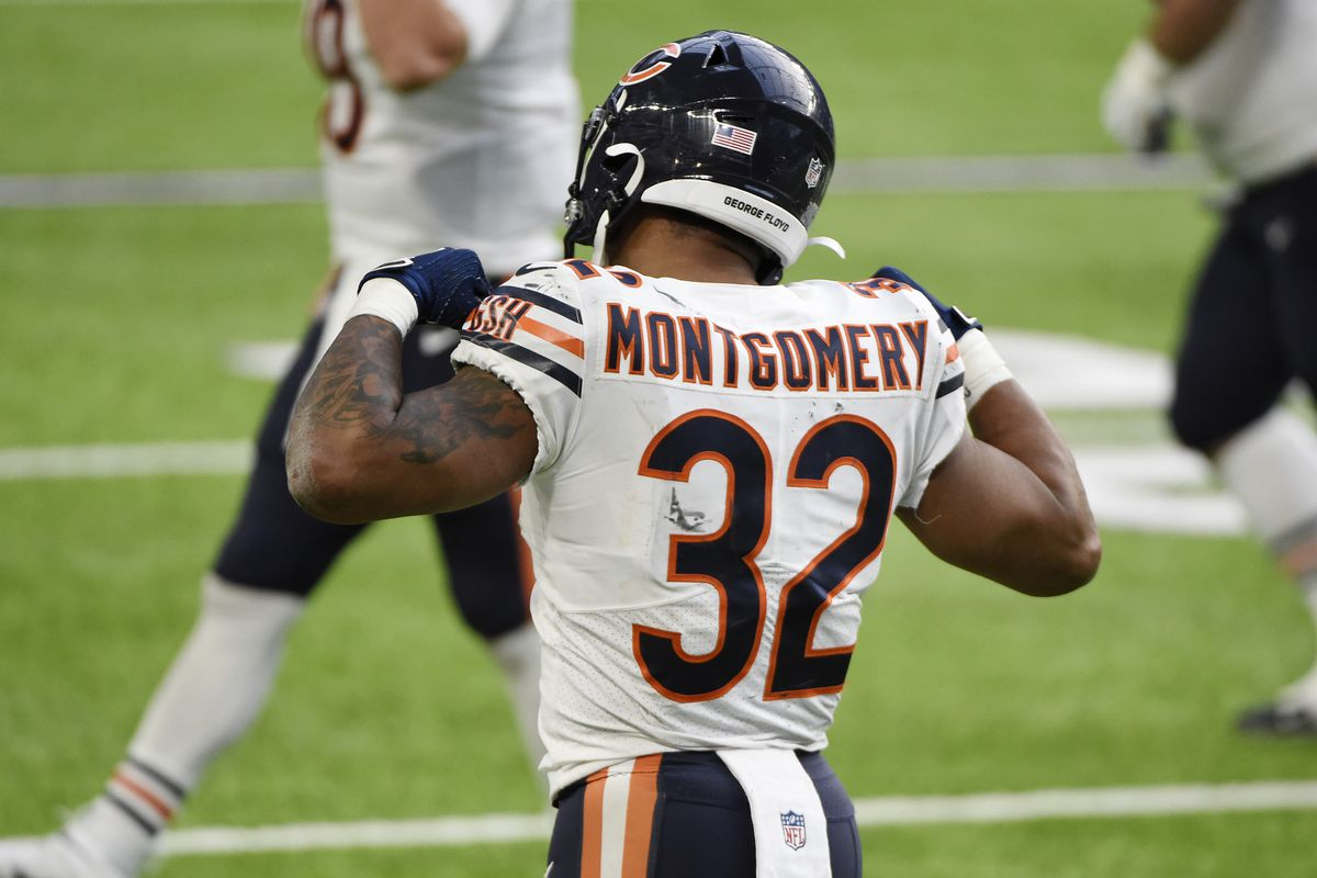 David Montgomery #32 of the Chicago Bears celebrates after scoring a third quarter touchdown against the Minnesota Vikings at U.S. Bank Stadium on December 20, 2020 in Minneapolis, Minnesota.