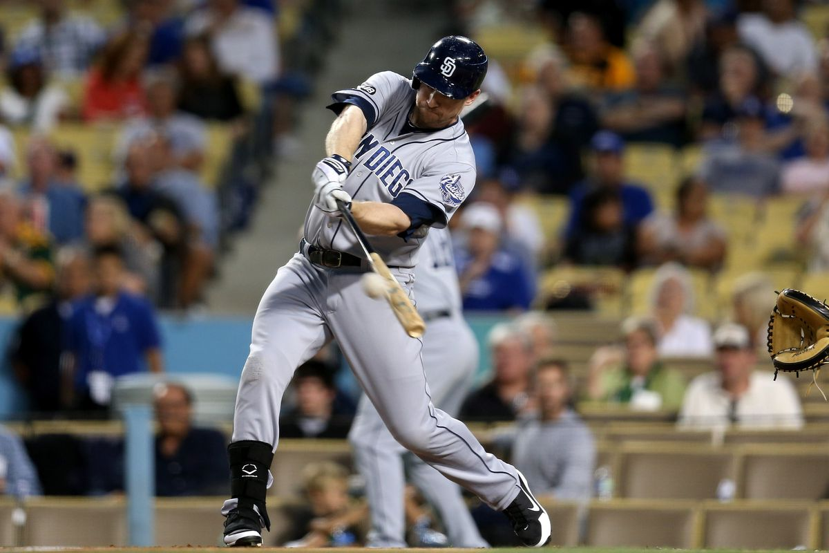 Let's just assume this ball left the park.  With the way Chase Headley has been swinging, it makes sense.  (Photo by Stephen Dunn/Getty Images)
