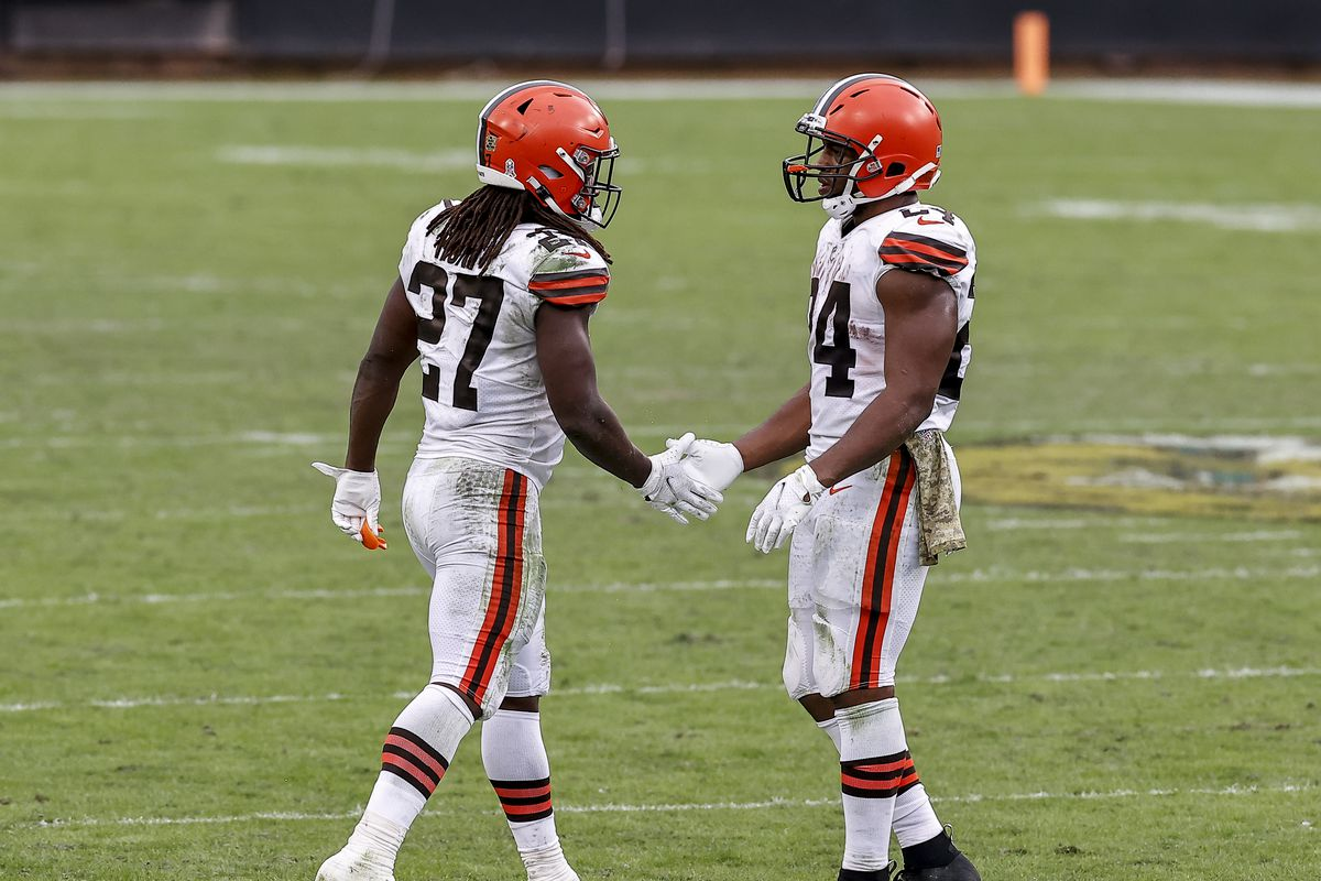 Runningbacks Kareem Hunt #27 and Nick Chubb #24 of the Cleveland Browns shake hands after the game against the Jacksonville Jaguars at TIAA Bank Field on November 29, 2020 in Jacksonville, Florida.
