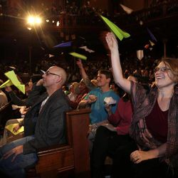Audience members throw paper airplanes during a performance at the Ig Nobel Prize ceremony at Harvard University, in Cambridge, Mass., Thursday, Sept. 20, 2012. The Ig Nobel prize is an award handed out by the Annals of Improbable Research magazine for silly sounding scientific discoveries that often have surprisingly practical applications.
