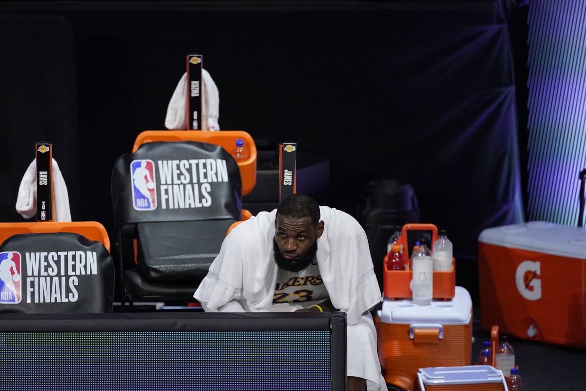Los Angeles Lakers forward LeBron James watches play against the Denver Nuggets from the bench during the second half of Game 3 of the NBA basketball Western Conference final Tuesday, Sept. 22, 2020, in Lake Buena Vista, Fla.