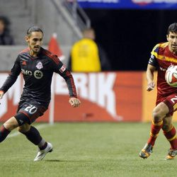 Real Salt Lake defender Tony Beltran (2) moves the ball past Toronto FC midfielder Issey Nakajima-Farran (20) during a game at Rio Tinto Stadium in Sandy on Saturday, March 29, 2014.