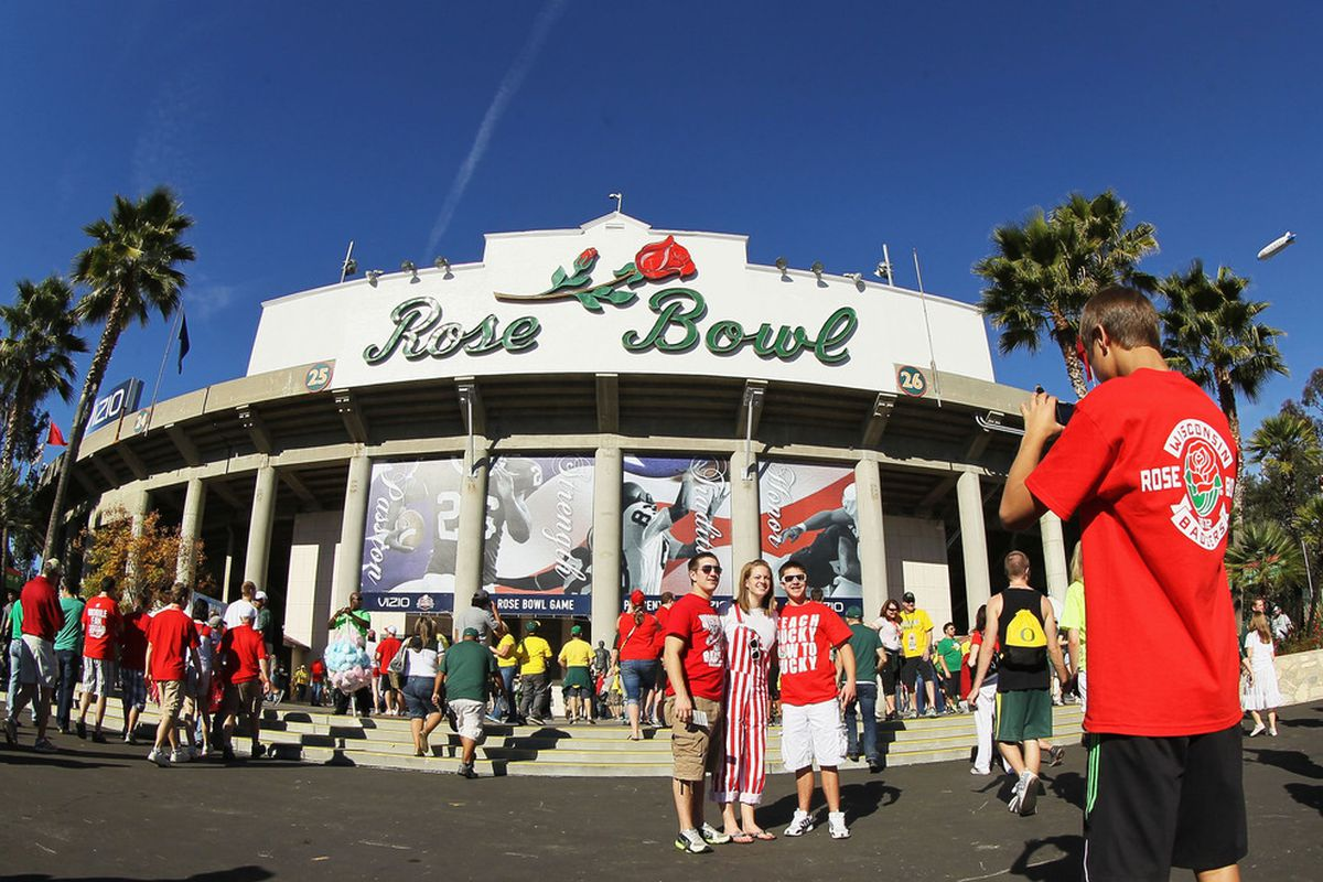 PASADENA, CA - JANUARY 02:  Wisconsin Badgers fans take pictures outside before the 98th Rose Bowl Game on January 2, 2012 in Pasadena, California.  (Photo by Stephen Dunn/Getty Images)