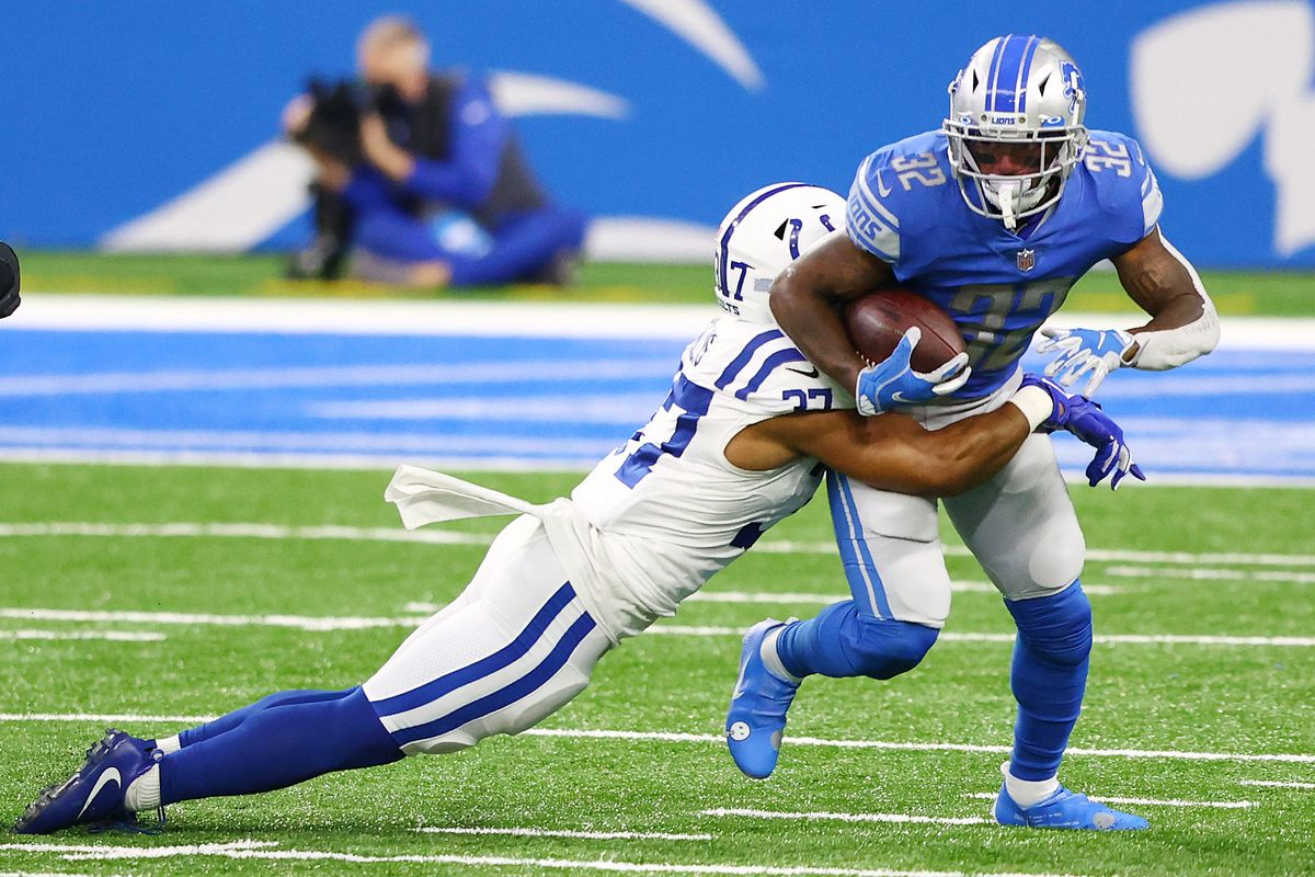 Khari Willis #37 of the Indianapolis Colts tackles D'Andre Swift #32 of the Detroit Lions during the third quarter at Ford Field on November 01, 2020 in Detroit, Michigan.
