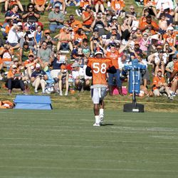 Broncos OLB Von Miller dances in front of an excited crowd at Broncos camp.