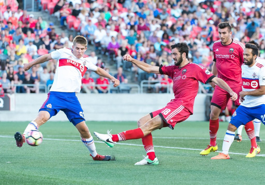 USL Photo - TFC II's Fraser gets an early block in on Ottawa's Hume