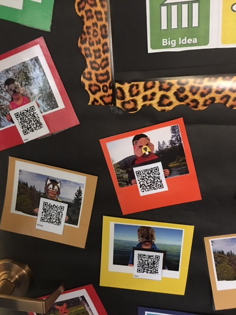The QR codes attached to each picture allow students to watch the videos their classmates have made.