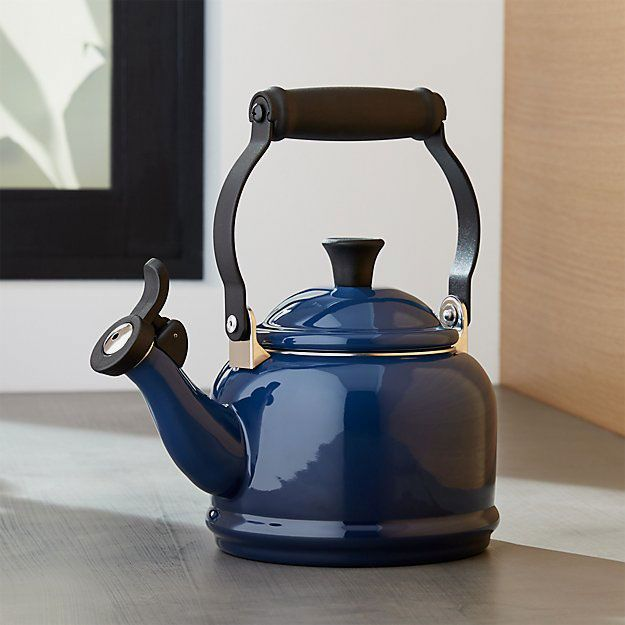 A navy blue cast-iron tea kettle