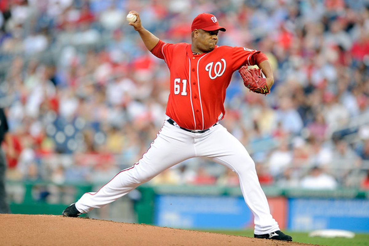WASHINGTON - JUNE 04:  Livan Hernandez #61 of the Washington Nationals pitches against the Cincinnati Reds at Nationals Park on June 4, 2010 in Washington, DC.  (Photo by Greg Fiume/Getty Images)