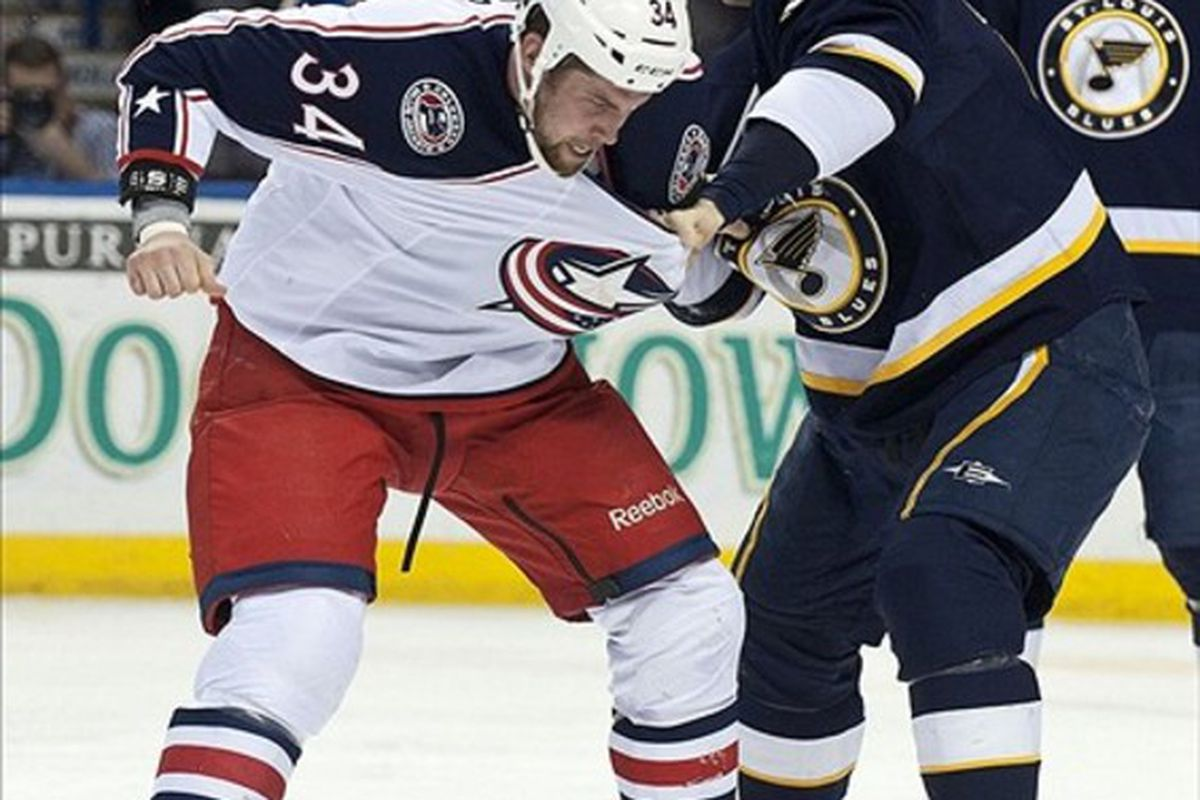 Mar 10, 2012; St. Louis, MO, USA; Columbus Blue Jackets left wing Dane Byers (34) fights with St. Louis Blues right wing B.J. Crombeen (26) during the second period at Scottrade Center.  Mandatory Credit: Ed Szczepanski-US PRESSWIRE