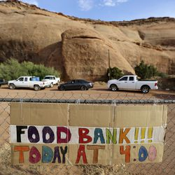 People line up for a drive-thru food bank, organized by Transitions Pantry, in Oljato-Monument Valley, San Juan County, on Thursday, April 30, 2020. The Navajo Nation has one of the highest per capita COVID-19 infection rates in the country.