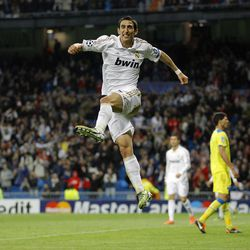 Real Madrid's Angel Di Maria from Argentina, center, celebrates his goal against APOEL Nicosia with during a second leg Champions League quarterfinal soccer match at the Santiago Bernabeu stadium, in Madrid, Wednesday, April 4, 2012.