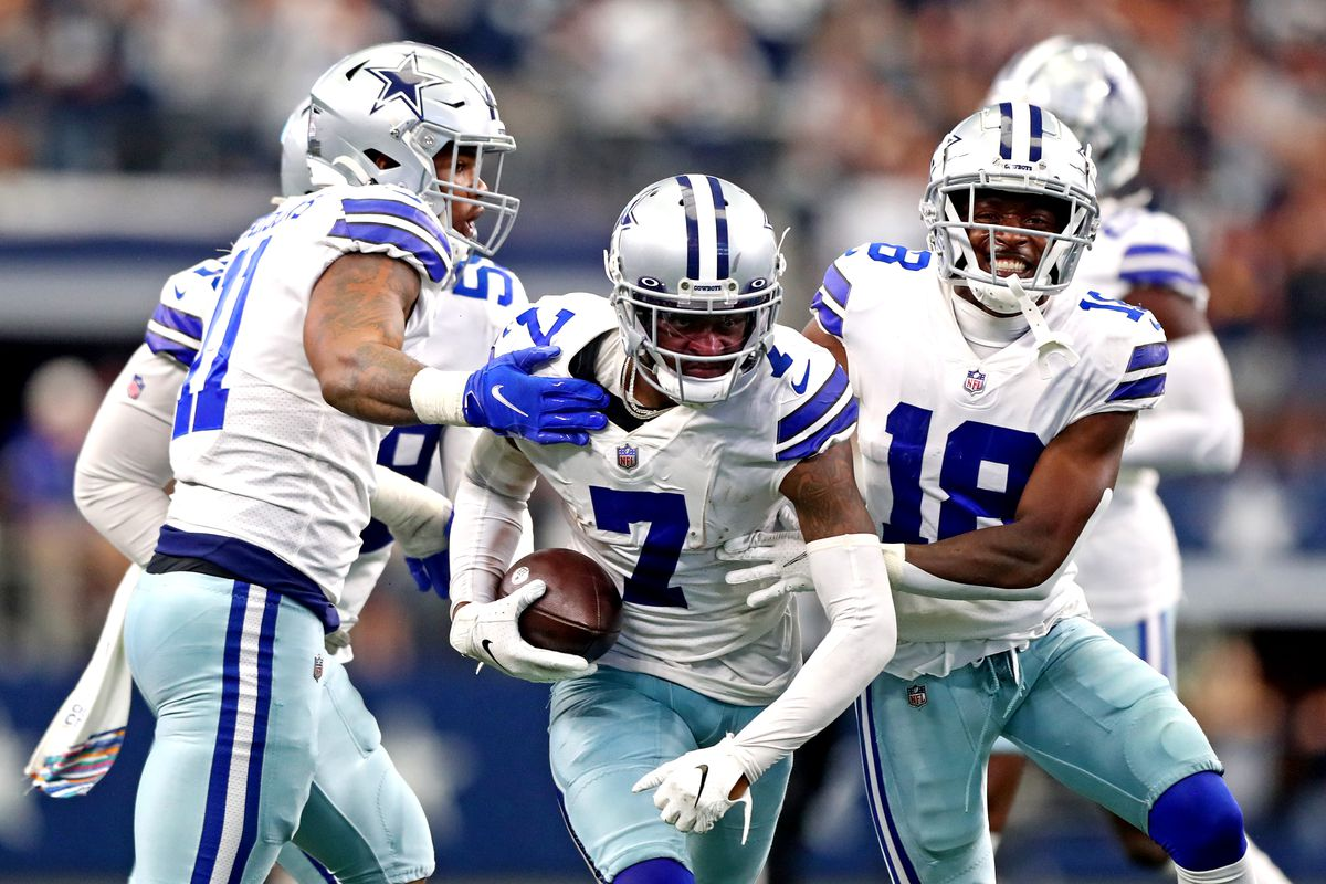 Dallas Cowboys cornerback Trevon Diggs (7) celebrates after making an interception on a pass intended for Carolina Panthers wide receiver D.J. Moore (not pictured) during the second half at AT&T Stadium.
