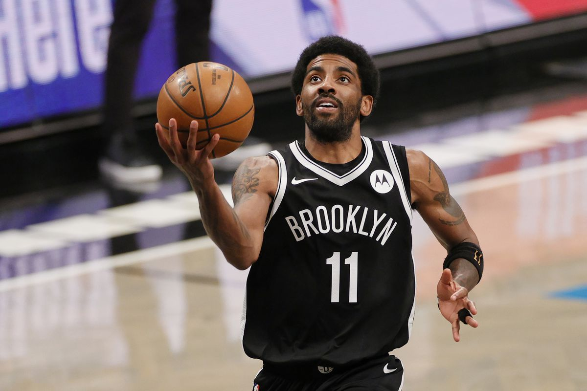 Kyrie Irving #11 of the Brooklyn Nets goes to the basket during the second half against the Boston Celtics at Barclays Center on April 23, 2021 in the Brooklyn borough of New York City.