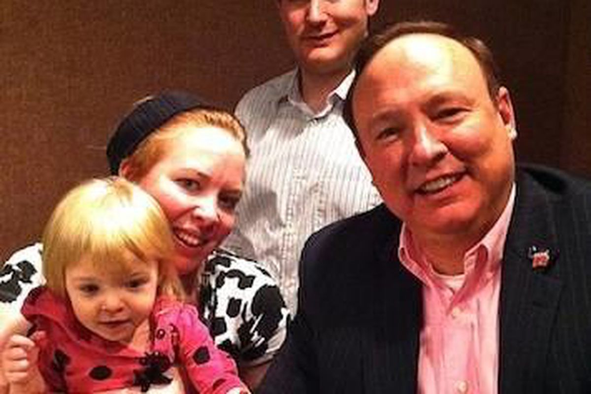 Crystal Young-Otterstrom, left, with daughter, and Craig Janis and Jim Dabakis, head of the Utah State Democratic Party.